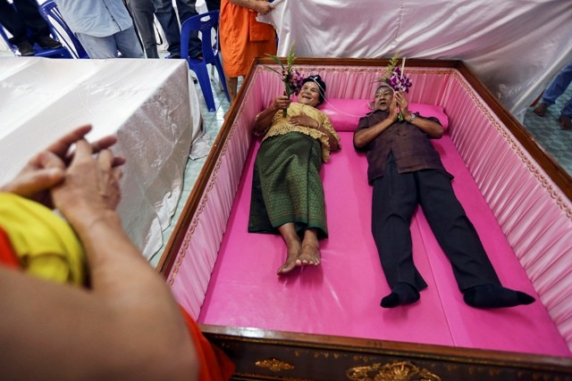 Bride and Groom Exchange Wedding Vows in Coffins in Bangkok.