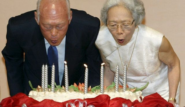 Lee Kuan Yew, architect of modern Singapore, and his wife Kwa Geok Choo (R) blow out candles on his birthday cake as he celebrates his 80th birthday in Singapore in this September 16, 2003 file photo