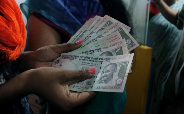 A woman withdraw money from ATM