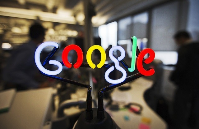 A neon Google logo is seen at the Google office in Toronto.