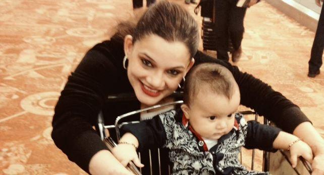 "Kanika Maheshwari joins ""The Kapil Sharma Show."" Pictured: Kanika Maheshwari with her child."