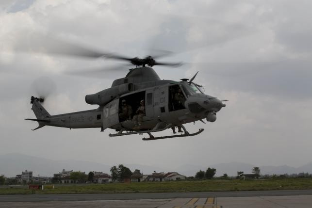 A UH-1Y Huey helicopter flies into the Tribhuvan International Airport after a search and rescue operation in Kathmandu, Nepal, May 13, 2015.