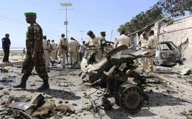 Somalia's army soldiers and peacekeepers from the African Union Mission in Somalia (AMISOM) gather at the scene of an explosion in front of the airport in Somalia's capital Mogadishu, December 3, 2014.