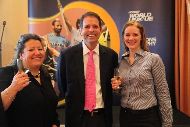 FIH Chief Executive Officer Kelly Fairweather (centre) with CEOs Sally Munday of England Hockey (left) and Hockey India's Elena Norman (right)