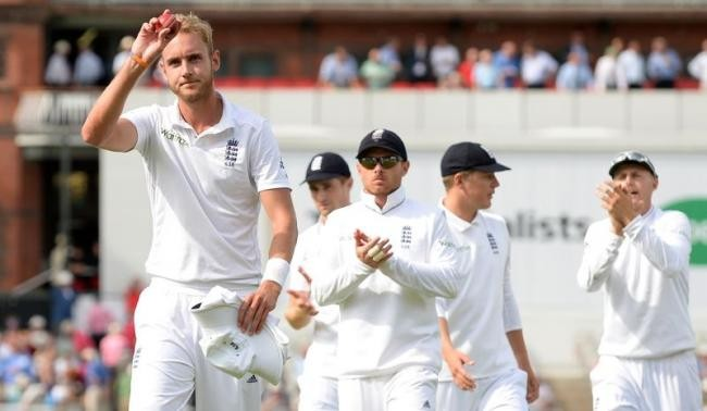 England's Stuart Broad holds the ball as he leaves the field after taking six wickets during the fourth cricket test match against India at the Old Trafford cricket ground in Manchester, England
