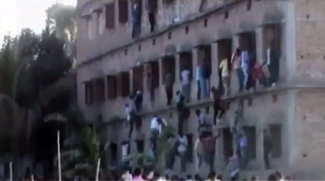 Open Cheating: Parents help Class 10 students during board exams in Bihar.