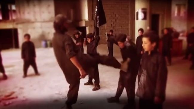 The Islamic State (ISIS) militants have released a video where adult jihadists train young boys with harsh treatments such as kicking and lashing.