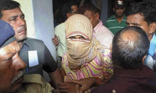 Police Officers Escort Manoj Kumar Accused of Raping and Torturing a Five-Year-Old Girl, at a Court in Muzaffarpur in Bihar