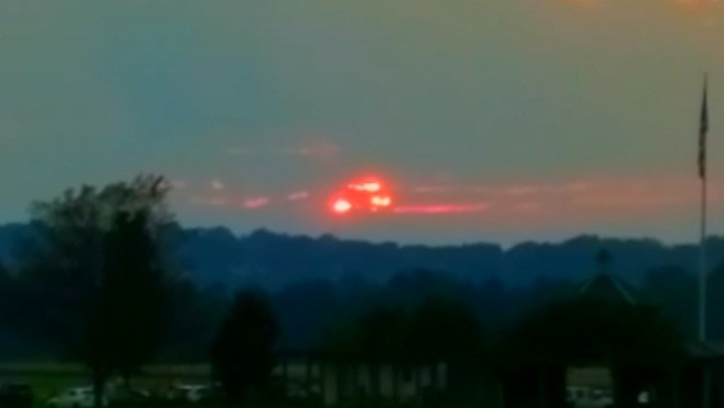 Image result for Nibiru red object glows behind clouds in cincinnati