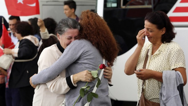 An employee at Turkey's consulate in Mosul is welcomed by her relatives at Esenboga airport in Ankara.