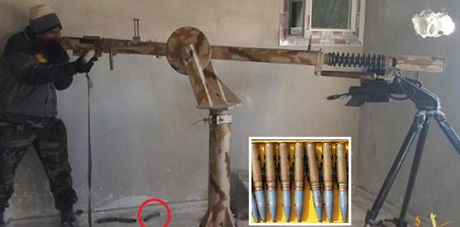An ISIS fighter aims the giant 10 foot long sniper gun out of a window in Kobane. (inset): An image of the 23 mm bullet that is fired from the ISIS gun show in the pic.