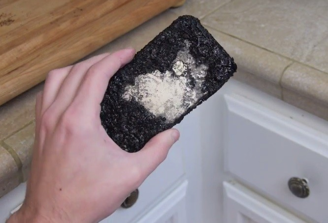 A destroyed iPhone 6 after it was boiled in a pan of Coca Cola.