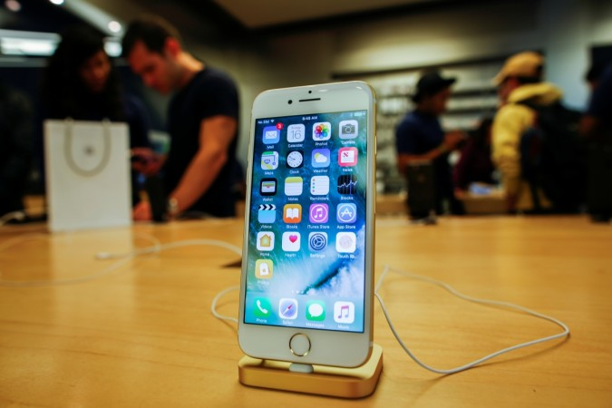Customers take a look at the new iPhone 7 smartphone