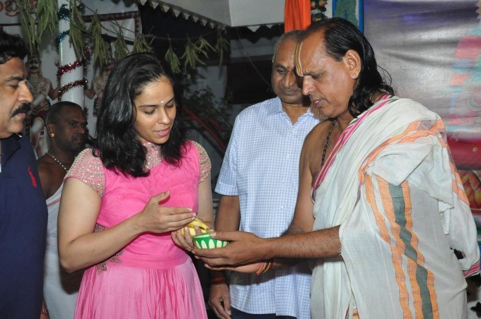 Check out the photos of Badminton Player Saina Nehwal visits Film Nagar Temple in Hyderabad.