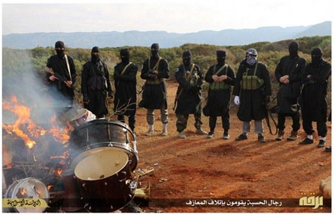 Isis fighters in Libya have released pictures where they have burnt musical instruments .