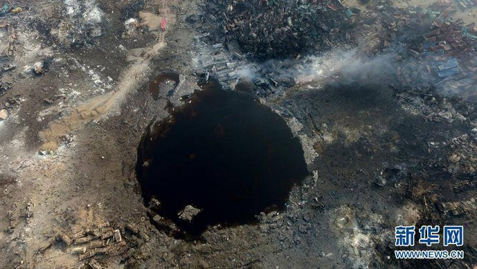Tianjin Blast,Tianjin blasts,tianjin crater,crater at tianjin blast site,huge crater,tianjin,china blast,tianjin explosion pictures,china chemical factory blast