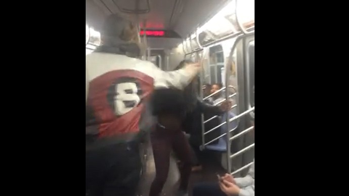 A video of an epic brawl inside a New York City Subway train where 'man slaps soul out of girl' goes Viral.
