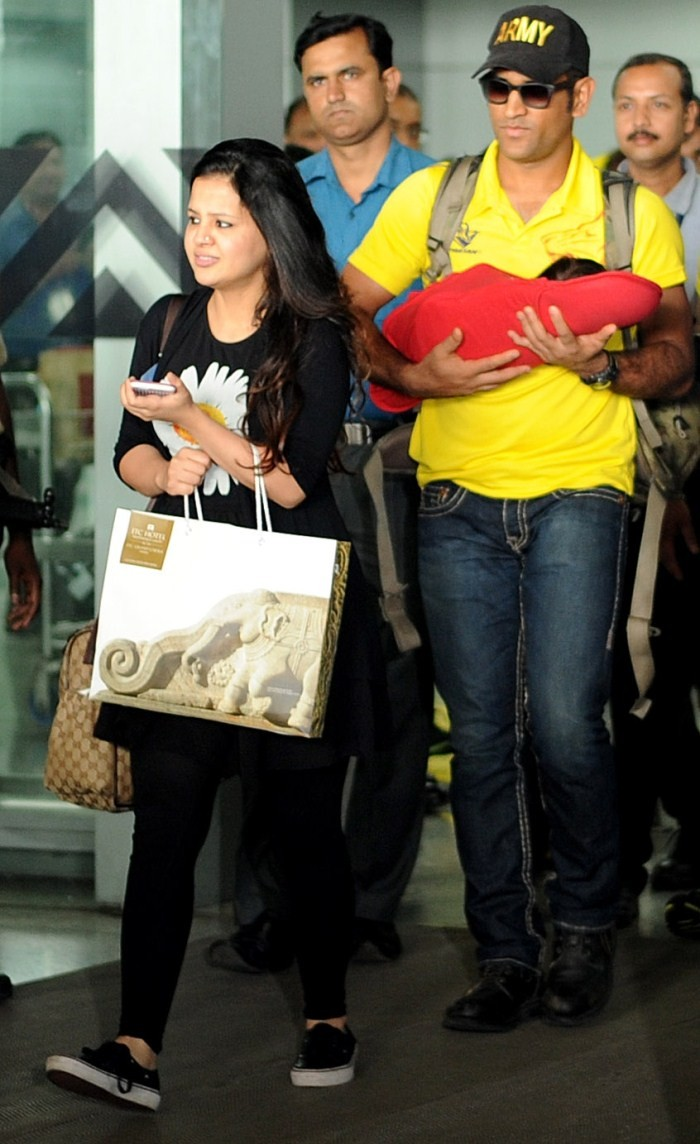 MS Dhoni,Sakshi,Ziva,MS Dhoni wife Sakshi,MS Dhoni daughter Ziva,Chennai Super Kings,International Airport,MS Dhoni with ziva,MS Dhoni with Sakshi,MS Dhoni pics,MS Dhoni images,MS Dhoni photos