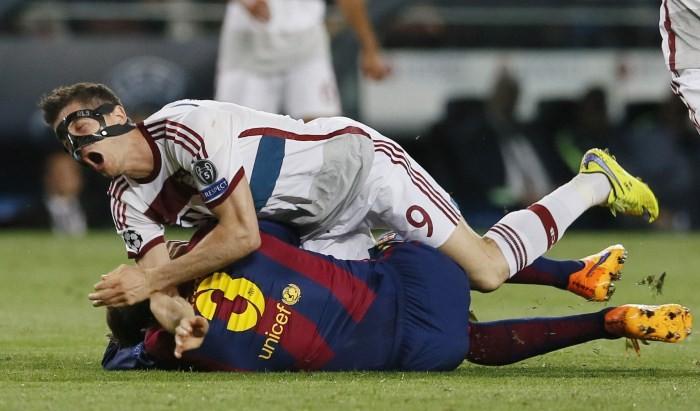 Barcelona's Gerard Pique in action with Bayern Munich's Robert Lewandowski