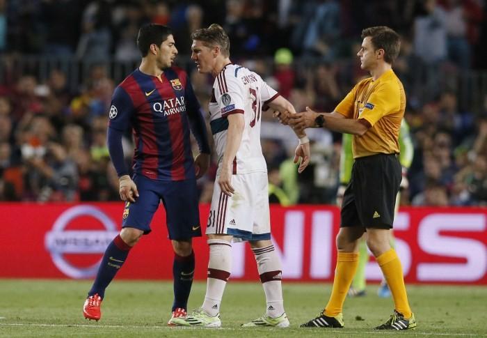 Barcelona's Luis Suarez clashes with Bayern Munich's Bastian Schweinsteiger as referee Nicola Rizzoli