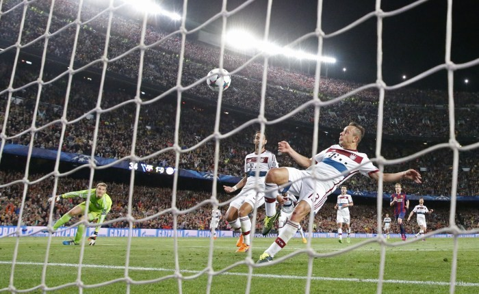 Barcelona's Lionel Messi (not pictured) scores their second goal as Bayern Munich's Rafinha attempts to clear