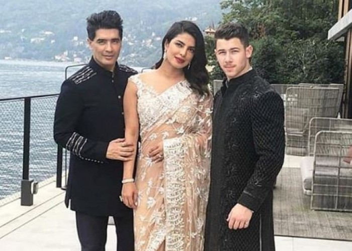 Priyanka Chopra and fiance Nick Jonas with Manish Malhotra