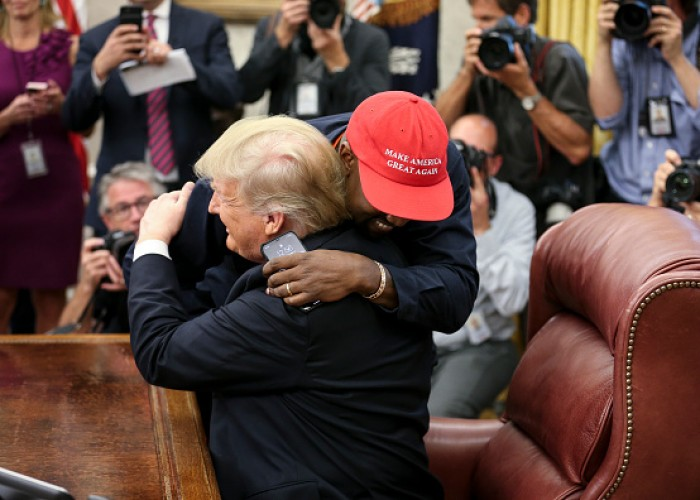 Rapper Kanye West hugs U.S. President Donald Trump