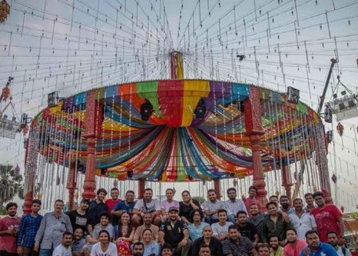 The entire BTS team of Salman Khan Films' upcoming romantic drama 'Loveratri' poses for a happy picture on the sets of the film. Shooting for the ongoing schedule of the film in Gujarat, team 'Loveratri' is having a great time filming the colourful film. Recently, the team wrapped the London schedule of the film. Earlier, Loveratri shot its first schedule in Gujarat that included rigorous Garba training. Aayush Sharma has time and again treated the audience with on set pictures giving glimpses into the film. The actors also underwent training sessions before commencing the shoot. The varied pictures and insights have generated immense curiosity amongst the audience to witness the film. Uploading the crew of the film, Arpita Khan Sharma posted a picture of the behind the camera team saying,