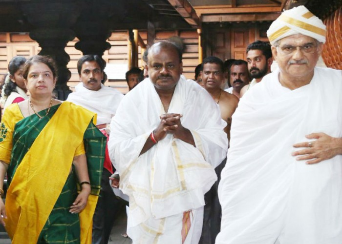 A day ahead of his swearing-in, Karnataka Chief Minister-designate H.D. Kumaraswamy on Tuesday visited the Hindu holy towns of Dharmasthala and Sringeri to pray for the success of the Congress-(JD-S) coalition government. The Janata Dal-Secular (JD-S) leader returned to the southern state after a day-long visit on Monday to Delhi to discuss government formation with Congress leaders Sonia Gandhi and Rahul Gandhi.