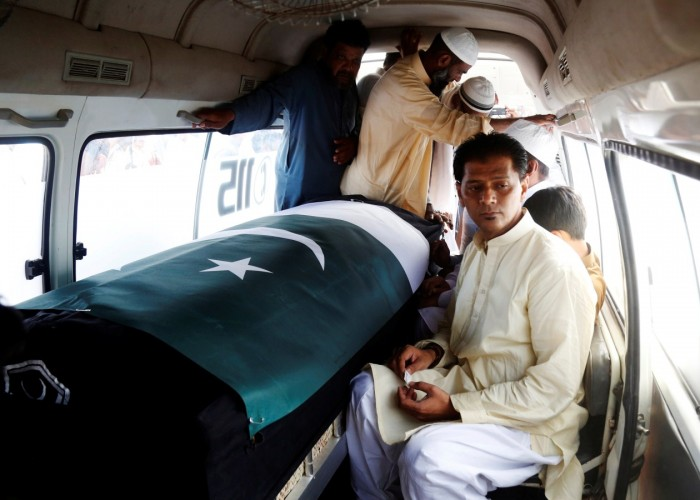 A Pakistani exchange student killed in a mass shooting in Texas was buried in her home town of Karachi, her coffin draped with Pakistan's green and white flag. Aziz Sheikh father of Sabika Aziz Sheikh, a Pakistani exchange student, who was killed with others when a gunman attacked Santa Fe High School in Santa Fe, Texas, U.S., sits in an ambulance next to her coffin, wrapped in national flag, during a funeral in Karachi, Pakistan May 23, 2018.