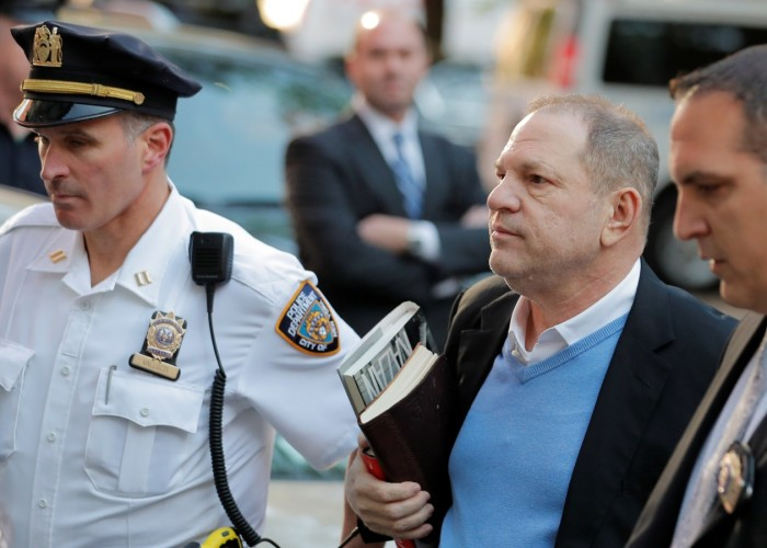 Hollywood film producer Harvey Weinstein, accused by over 80 women of sexual harassment, on Friday surrendered to police here to face charges of sexual misconduct more than seven months after the allegations first surfaced publicly. Weinstein, 66, turned himself into authorities at the first precinct in Manhattan on Friday. He was arrested shortly thereafter, the New York Police Department said. He is expected to be charged and brought on trial later on Friday, according to hollywoodreporter.com. The Oscar-winning producer landed in a twin expose in The New York Times and The New Yorker that was published in October and chronicled a pattern of alleged harassment and sexual assault of both actresses and employees at Weinstein's studios Miramax and its successor, The Weinstein Co. In no time, high-profile actresses like Ashley Judd, Rose McGowan, Mira Sorvino, Angelina Jolie and Gwyneth Paltrow came forward with claims against the producer. Weinstein, wearing a white button-down shirt and light-blue sweater under a black blazer and grey pants and carrying two books, entered the first precinct police station in Manhattan's Tribeca neighbourhood. He remained silent even though the reporters, photographers and TV news crews camped outside of the police department shouted questions at him, including