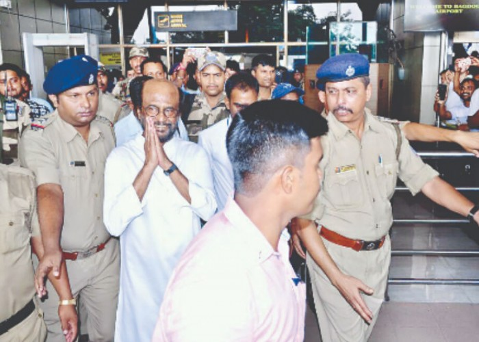 A frenzied, thousand strong crowd wildly cheered and called out his name as Tamil superstar Rajinikanth stepped out of the airport terminal at Bagdogra near here on Wednesday on his first shooting assignment in the northern West Bengal hills. Sporting a white linen kurta, the actor, who enjoys a demigod status in large parts of south India, had a tough time boarding the steel grey Fortuna car a few metres away, amid the thunderous cries and frantic bids to capture his movements on mobile camera. Rajinikanth seemed bowled over by the reception.