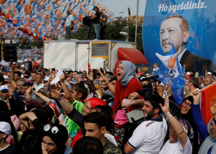 Polls suggest Sunday's vote may be close, with the AK Party possibly losing its parliamentary majority and the presidential vote potentially going to a second round. A girl in a wheelchair is raised in the air to watch Turkish President Tayyip Erdogan during an election rally in Istanbul, Turkey June 22, 2018.