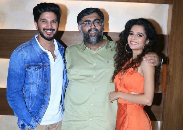 South Indian Superstar Dulquer Salmaan and internet sensation Mithila Palkar who are all set to make their Bollywood debut with Akarsh Khurana directorial 'Karwaan', were snapped promoting the film in Mumbai. Ahead of the release of the road trip film Karwaan, actors Dulquer Salmaan and Mithila Palkar were seen promoting the film along with director Akarsh Khurana. Marking the debut of the two actors, Karwaan brings together the best of all worlds as Dulquer and Mithila make their debut with global icon Irrfan. Karwaan starring Irrfan and marking the debut of Dulquer Salmaan and Mithila Palkar, revolves around 3 oddballs from different walks of life who are thrown together on a somewhat bizarre journey which helps them find normalcy in their lives.