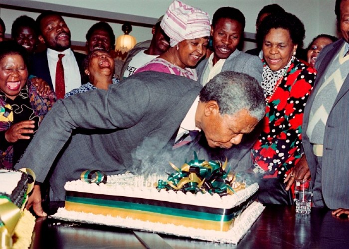 Nelson MandelaSouth African anti-apartheid leader and African National Congress (ANC) member Nelson Mandela blows candles on his 72nd birthday cake, the first he has celebrated as a free man since 1960, on July 18, 1990 in his Soweto home as his then-wife anti-apartheid campaigner Winnie (c), family and friends look on.