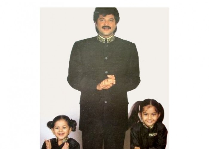 Sonam Kapoor Ahuja on Thursday treated her fans with an adorable throwback picture from her childhood. The 'Veere Di Wedding' star shared an image that features a young Sonam and sister Rhea, shyly posing with dad Anil Kapoor. She wrote alongside,