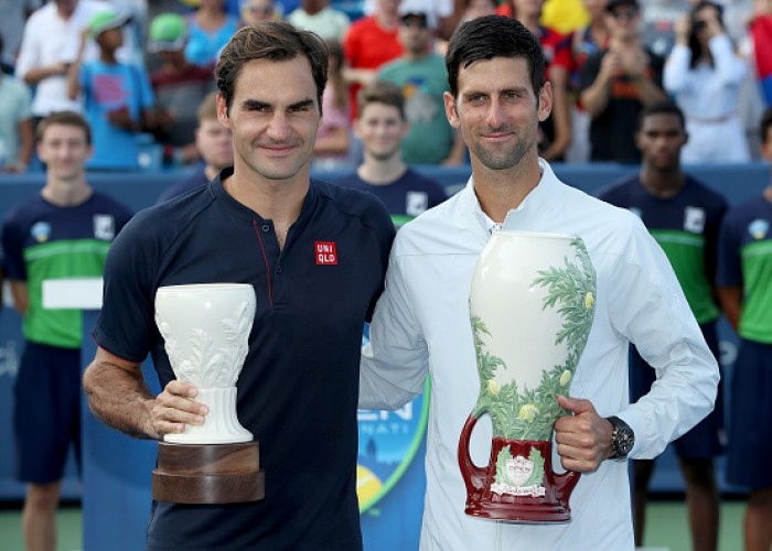 Roger Federer of Switzerland and Novak Djokovic of Serbia pose for photographers after their match