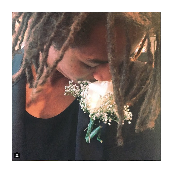 Jaden Smith smelling his brooch