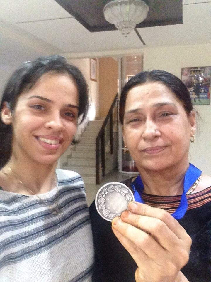 Saina Nehwal and mother with YONEX All England Open Badminton Medal.