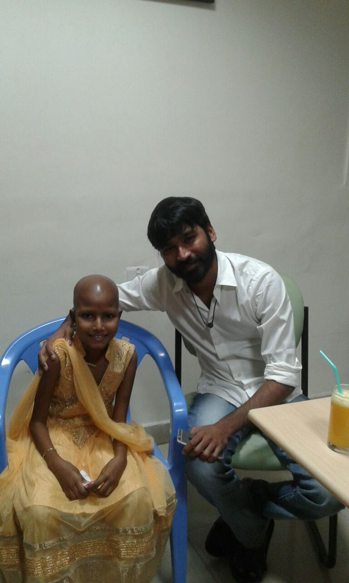 Dhanush,Dhanush meets blood cancer patient Kotiswari,Dhanush meets Kotiswari,Kotiswari blood cancer patient,actor Dhanush,Dhanush latest pics,Dhanush latest images,Dhanush latest photos,Dhanush latest stills,Dhanush latest pictures