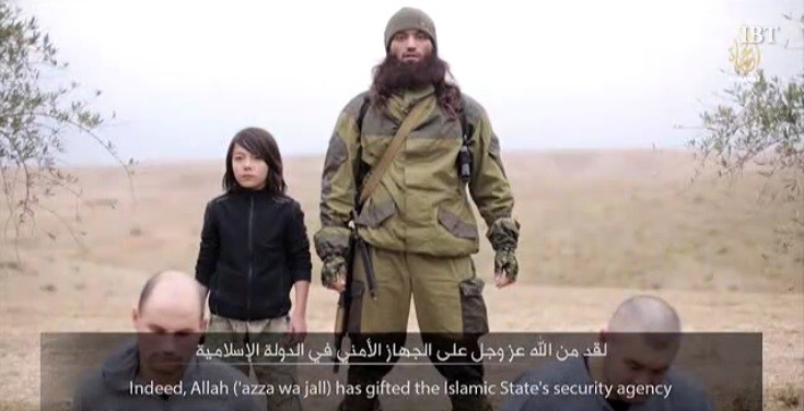 ISIS prpaganda video shows a child soldier shooting dead two Russian Spies