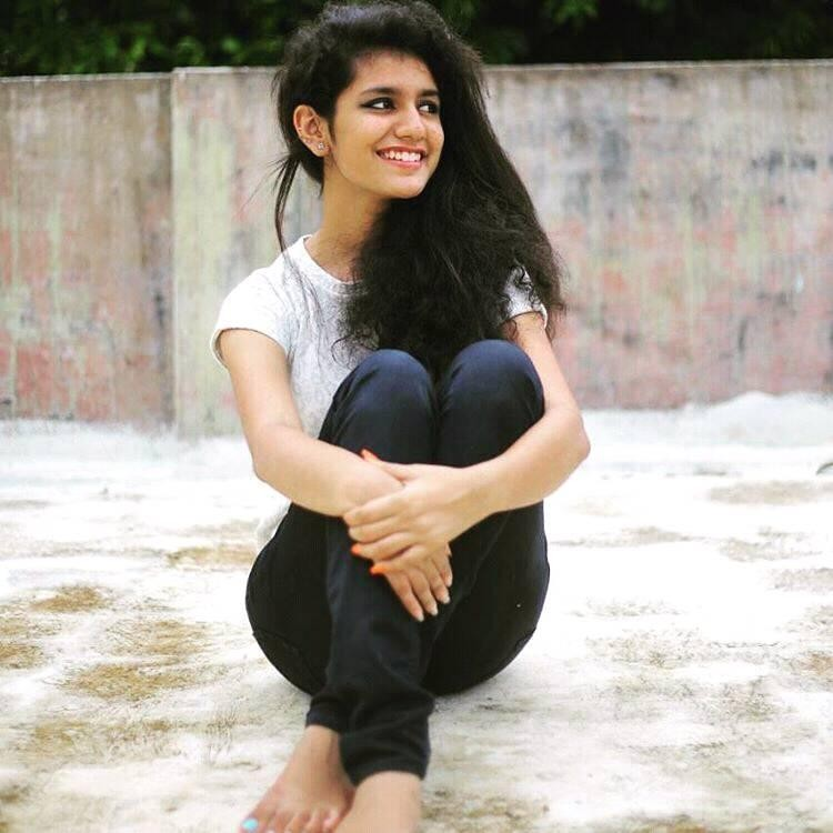 Winking girl,winking girl video,who is the winking girl in viral video,Priya Prakash Varrier,Priya Prakash winking girl,Valentine's Day,Winking girl memes,omar lulu,Oru Adaar Love,Manikya Malaraya Poovi,winking video song