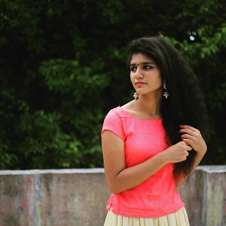 Winking girl,winking girl video,who is the winking girl in viral video,Priya Prakash Varrier,Priya Prakash winking girl,Valentine's Day,Winking girl memes,omar lulu,Oru Adaar Love,Manikya Malaraya Poovi,winking video song