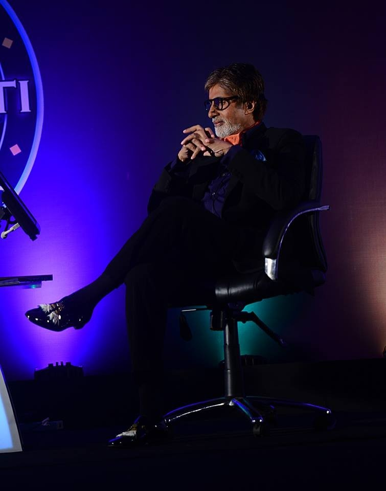 Big B at the show's press conference with his Earrings encrusted Shoes