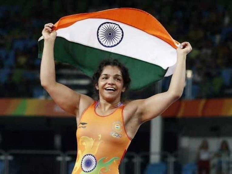 Rio Olympics 2016,Wrestler Sakshi Malik,Sakshi Malik,Sakshi Malik  at closing ceremony,closing ceremony,Rio closing ceremony,Rio 2016 closing ceremony,Sakshi to carry tricolour,Olympics closing ceremony,Olympics closing ceremony pics,Olympics closing cere