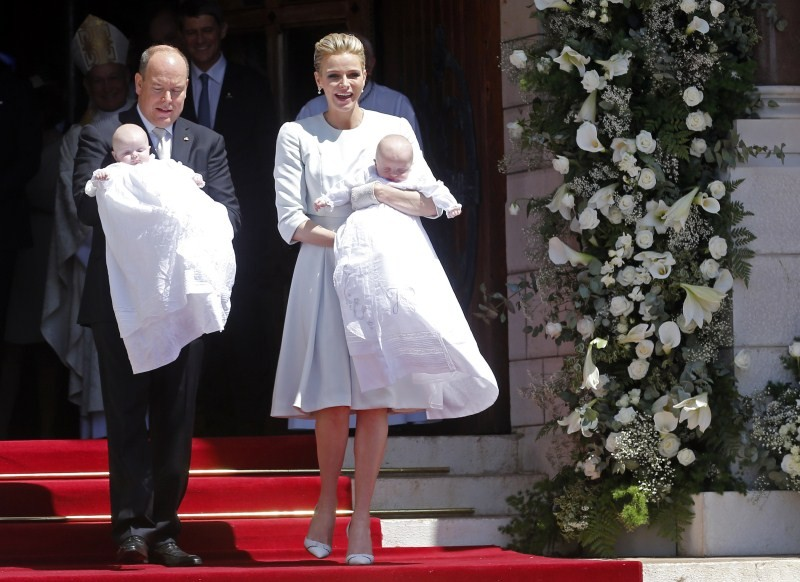 Prince Albert II of Monaco and his wife Princess Charlene hold their twins Prince Jacques (R) and Princess Gabriella (L)