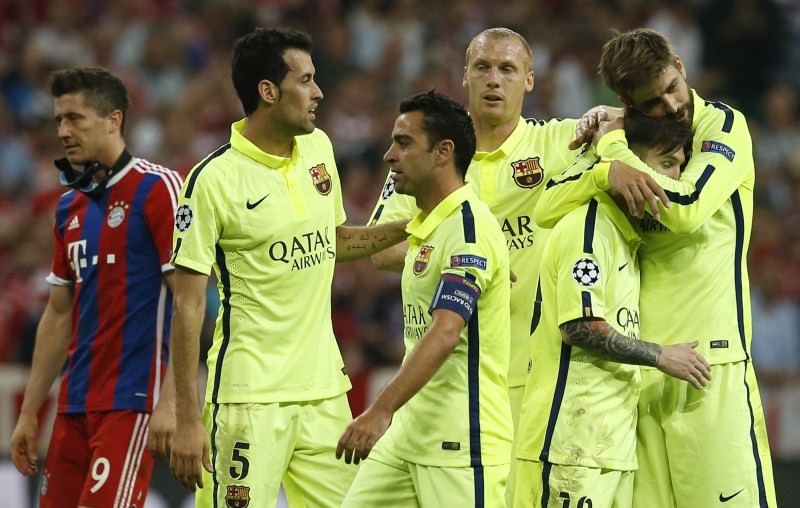Barcelona's Sergio Busquets, Xavi, Jeremy Mathieu, Lionel Messi and Gerard Pique celebrate at the end after reaching the UEFA Champions League Final