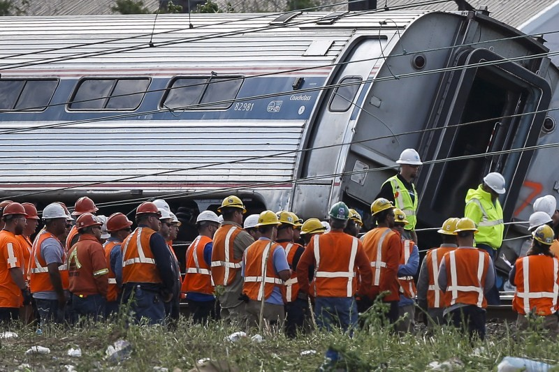 The accident left rail cars mangled, ripped open and strewn upside down in the city's Port Richmond neighborhood along the Delaware River.
