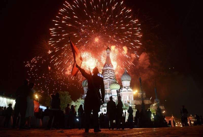 Fireworks explodes over Red Square, with St. Basil's Cathedral seen on the background, during the Victory Day celebrations in Moscow, Russia