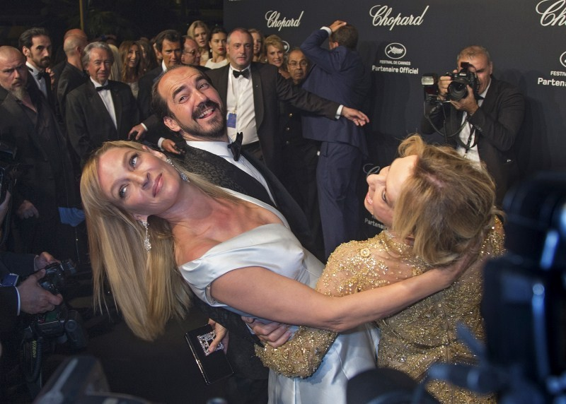Actress Uma Thurman (C) and Caroline Scheufele, Artistic Director and Co-President of Chopard (R) pose during a photocall